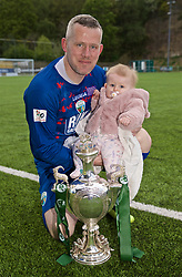 RHOSYMEDRE, WALES - Sunday, May 5, 2019: The New Saints captain goalkeeper Paul Harrison celebrates with the trophy and his 8-month-old daughter Eva after the FAW JD Welsh Cup Final between Connah's Quay Nomads and The New Saints at The Rock. The New Saints won 3-0. (Pic by David Rawcliffe/Propaganda)