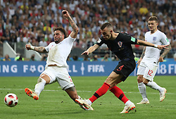 MOSCOW, July 11, 2018  Kyle Walker (L) of England vies with Ivan Perisic (C) of Croatia during the 2018 FIFA World Cup semi-final match between England and Croatia in Moscow, Russia, July 11, 2018. Croatia won 2-1 and advanced to the final. (Credit Image: © Cao Can/Xinhua via ZUMA Wire)