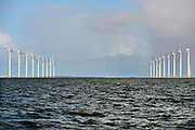 Nederland, the Netherlands, 18-2-2016   NOP Agrowind, energiebedrijf RWE Essent en Westermeerwind bouwen een windpark op land en in het water van het IJsselmeer. De stroomproducent bouwt hier windmolens die  5 megawatt op land, en 3 megawatt op zee produceren. Siemens levert en installeert de turbines. Het bedrijf Turbine Transfers verzorgt met snelle bootjes de aan en afvoer van personeel dat op de werkschepen in in de turbines moet werken.FOTO: FLIP FRANSSEN/ HH