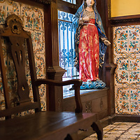 A painted wooden statue of the Virgin Mary inside of the Casa de Aliaga in downtown Lima, Peru. After the founding of Lima on January 18th, 1535, Captain Jerónimo de Aliaga y Ramírez received a colonial house near Plaza Mayor and ever since then the Aliaga family and their descendants have lived in the house, making it the oldest dwelling in the Americas that has been home to the same family for 17 generations.