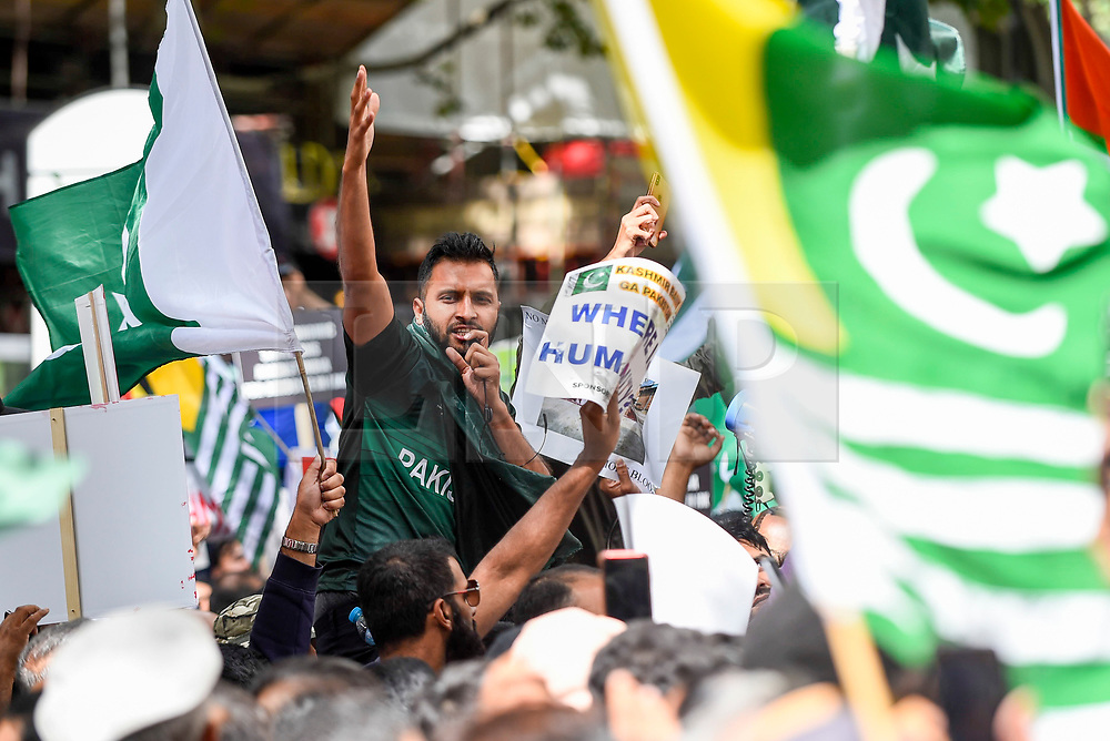 © Licensed to London News Pictures. 15/08/2019. LONDON, UK.  A man speaks on a microphone addressing thousands of protesters, many waving Pakistani and Kashmiri flags, outside the Indian High Commission in Aldwych, on what they are calling Black Day, to stand in solidarity with the people of Kashmir.  Indian Prime Minister Narendra Modi delivered an Independence Day speech highlighting his decision to remove the special rights of Kashmir as an autonomous region.  Photo credit: Stephen Chung/LNP