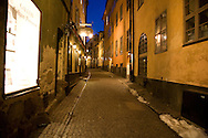 An illuminated street scene in the old part of Sweden's capital, Stockholm.