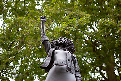© Licensed to London News Pictures. 15/07/2020. Bristol, UK. A statue of BLM protester Jen Reid, made by Mark Quinn is installed in Bristol on the empty plinth where the statue of 17th century slave trader and Bristol philanthropist Edward Colston used to stand. . Photo credit: Marcin Nowak/LNP