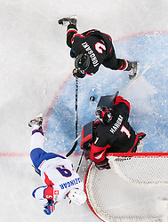 Tomaz Razingar of Slovenia vs Jun Tonosaki and Masahito Haruna of Japan during ice-hockey match between Slovenia and Japan at IIHF World Championship DIV. I Group A Slovenia 2012, on April 16, 2012 in Arena Stozice, Ljubljana, Slovenia. Slovenia defeated Japan 4-2. (Photo by Vid Ponikvar / Sportida.com)