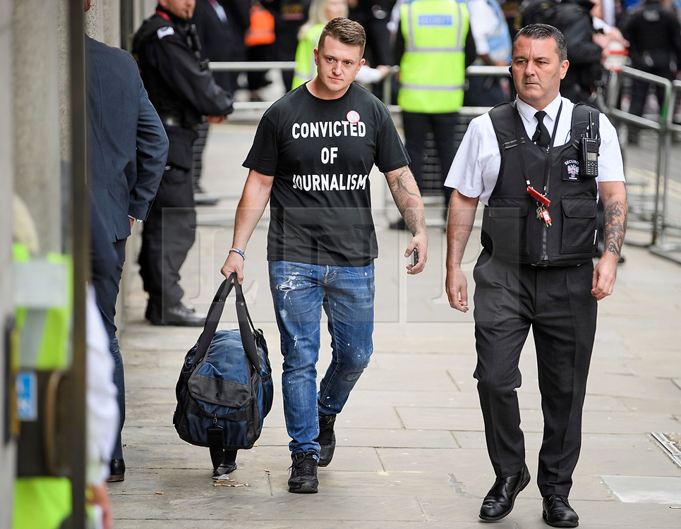 © Licensed to London News Pictures. 11/07/2019. London, UK. TOMMY ROBINSON arrives at court. Supporters of activist Stephen Yaxley-Lennon Known as Tommy Robinson, gather outside The Old Bailey in London ahead of his sentence. The former leader of the English Defence League (EDL) is being sentenced for contempt of court for filming defendants at a trial at Leeds Crown Court and broadcast the video on social media. Photo credit: Ben Cawthra/LNP