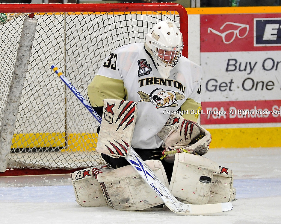 TRENTON, ON - Mar 21: OJHL North East Conference playoff series round two, Kingston Voyageurs vs. Trenton Golden Hawks. Denny Dubblestyne #33 of the Trenton Golden Hawks makes the save during third period game action.<br /> (Photo by Shawn Muir / OJHL Images)