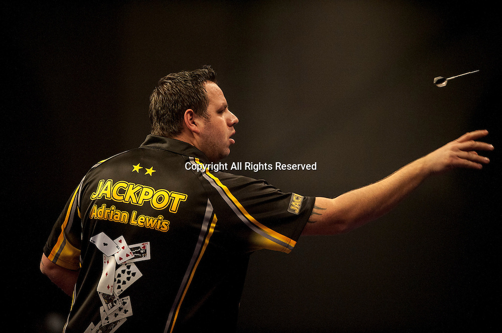 30.12.2014.  London, England.  William Hill PDC World Darts Championship.  Adrian Lewis (3) [ENG] in action on his way to a 9 dart finish in his match against Raymond van Barneveld (14) [NED].