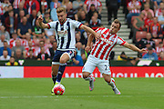 Stoke City midfielder Xherdan Shaqiri goes for tackle with West Bromwich Albion midfielder James Morrison during the Barclays Premier League match between Stoke City and West Bromwich Albion at the Britannia Stadium, Stoke-on-Trent, England on 29 August 2015. Photo by Aaron Lupton.