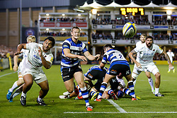 Bath Scrum-Half Chris Cook passes back under pressure from Saracens Number 8 Billy Vunipola - Photo mandatory by-line: Rogan Thomson/JMP - 07966 386802 - 03/10/2014 - SPORT - RUGBY UNION - Bath, England - The Recreation Ground - Bath Rugby v Saracens - Aviva Premiership.