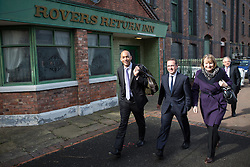 © Licensed to London News Pictures . 13/04/2015 . Manchester , UK . Members of the Shadow Cabinet arrive and walk past the set of Coronation Street and the Rovers Return Inn ahead of Labour Party leader Ed Miliband launching the Labour Party manifesto ahead of the General Election at the Old Granada Studios in Manchester , UK . Photo credit : Joel Goodman/LNP