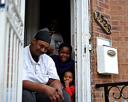 A young family who lives 6 houses away from the burnt out CVS pharmacy smile and rejoice following a video interview with the father on May 1, 2015, in Baltimore, Md.