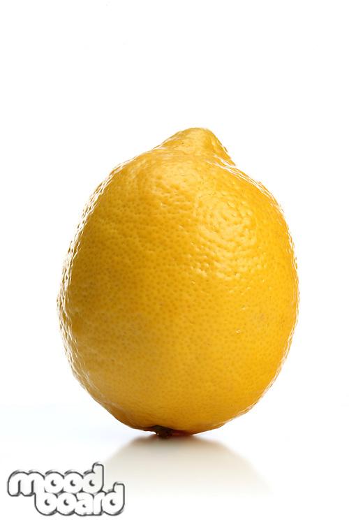 Studio shot of lemon on white background
