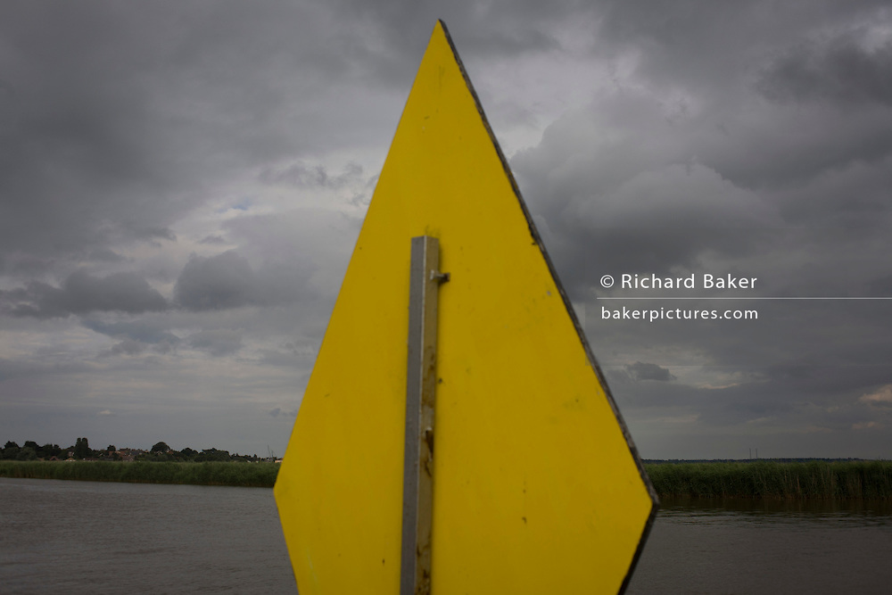 Reverse diamond sign for the chain ferry at Reedham on the Norfolk Broads.