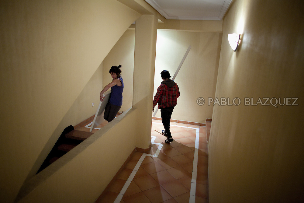 Anti-eviction supporters carry Tatyana's furniture along the hall of her appartment's building in the late hours on February 28 2012. Bulgarian Tatyana Roeva, and husband Anuar Jalil 55, from Libano, await their second evition since last June 2011 their first eviction meant the starting of the Anti-eviction movement. A day before their eviction February 29, 2012 a demonstration of hundreds of people takes part in Madrid claiming a lieu of payment for evicted families and social accomodation. During the demonstration lawyer Rafael Mayoral and the Anti-eviction organization got a deal with BBVA Bank for a lieu of payment of 269.000â¬, plus two months paid accomodation, but the couple needs to leave their house that night.