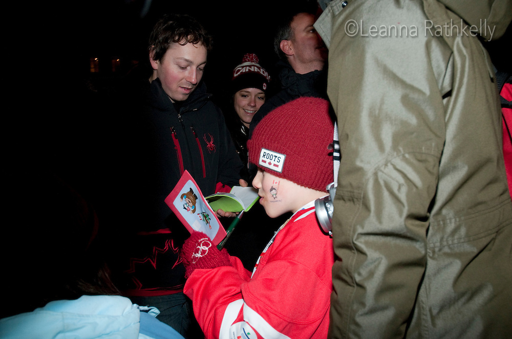 Canadian Alpine ski racer John Kucera signs autographs for kids during the 2010 Olympic Winter Games in Whistler, BC Canada. Kucera did not compete due to an injury in November 2009.