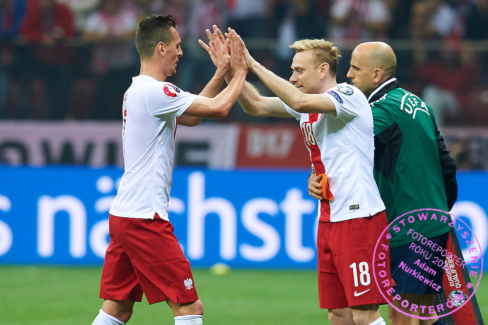 Substitution Poland's Sebastian Mila (R) for Poland's Arkadiusz Milik (L) during the EURO 2016 qualifying match between Poland and Germany on October 11, 2014 at the National stadium in Warsaw, Poland<br /> <br /> Picture also available in RAW (NEF) or TIFF format on special request.<br /> <br /> For editorial use only. Any commercial or promotional use requires permission.<br /> <br /> Mandatory credit:<br /> Photo by &copy; Adam Nurkiewicz / Mediasport