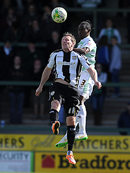 Yeovil Town's Nathan Smith challenges for the high ball with Garry Thompson of Notts County - Photo mandatory by-line: Harry Trump/JMP - Mobile: 07966 386802 - 11/04/15 - SPORT - FOOTBALL - Sky Bet League One - Yeovil Town v Notts County - Huish Park, Yeovil, England.