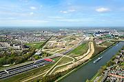 Nederland, Utrecht, Utrecht, 09-04-2014; Rijksweg A2 en de noordelijke ingang van de Leidsche Rijntunnel, een landtunnel die de verkeersoverlast, luchtvervuiling en geluidsoverlast voor Utrecht en de Vinexwijk Leidsche Rijn moet verminderen. Rechts het Amsterdam-Rijnkanaal met de stad Utrecht. Stadsbaan links van de tunnel. Tussen kanaal en tunnel zijn de contouren zichtbaar van de oude A2.<br /> Roadway A2 and the southern entrance to the tunnel Leidsche Rijn, a landtunnel built to decrease the nuisance of traffic noise and air pollution for the city of Utrecht and the suburb Leidsche Rijn . Right the Amsterdam-Rhine Canal and the city of Utrecht.<br /> luchtfoto (toeslag op standaard tarieven); aerial photo (additional fee required); copyright foto/photo Siebe Swart.
