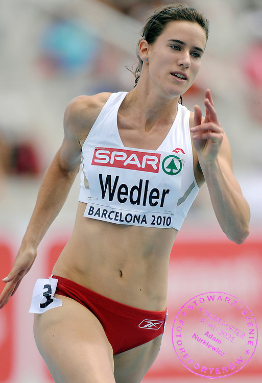 WERONIKA WEDLER (POLAND) COMPETES IN THE WOMEN'S 200 METERS QUALIFICATION DURING THE 2010 EUROPEAN ATHLETICS CHAMPIONSHIPS AT OLYMPIC STADIUM IN BARCELONA, SPAIN...SPAIN , BARCELONA , JULY 30, 2010..( PHOTO BY ADAM NURKIEWICZ / MEDIASPORT )..PICTURE ALSO AVAIBLE IN RAW OR TIFF FORMAT ON SPECIAL REQUEST.