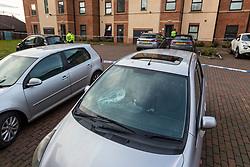 © Licensed to London News Pictures. 13/02/2019. Leeds UK. A car with a broken windscreen that has been cordoned off at the scene on Athlone Grove in Leeds this morning after the body of a woman was found inside a block of flats. A man has been arrested on suspicion of murder after he fell from a bridge over the A64 in Leeds. Photo credit: Andrew McCaren/LNP