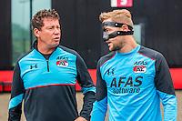 ALKMAAR - 27-07-2016, laatste training AZ voor Europese wedstrijd tegen Pas Giannina , AFAS Stadion, Assistent trainer Leeroy Echteld, AZ speler Rens van Eijden, masker.