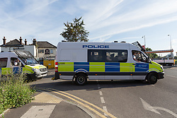 © Licensed to London News Pictures. 05/06/2017. LONDON, UK.  Police officers and van, believed to be containing terror suspects leaving from the rear of the Ship and Shovel pub in Dagenham this morning. One of the vans is believed to be containing terror suspects. Police carried out a raid at a Dagenham address early this morning in connection with the London Bridge terror attacks and residents reported hearing gun shots.  Photo credit: Vickie Flores/LNP