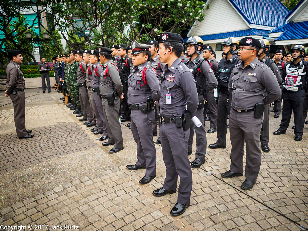 "08 APRIL 2017 - BANGKOK, THAILAND: Thai law enforcement and security personnel at the ""Amazing Songkran"" festival in Benchasiri Park in Bangkok. The festival was sponsored by the Tourism Authority of Thailand to highlight the cultural aspects of Songkran. Songkran is celebrated in Thailand as the traditional New Year's Day from 13 to 16 April. Songkran is in the hottest time of the year in Thailand, at the end of the dry season and provides an excuse for people to cool off in friendly water fights that take place throughout the country. Songkran has been a national holiday since 1940, when Thailand moved the first day of the year to January 1. Songkran 2017 is expected to be more subdued than Songkran usually is because Thais are still mourning the October 2016 death of revered King Bhumibol Adulyadej.       PHOTO BY JACK KURTZ"