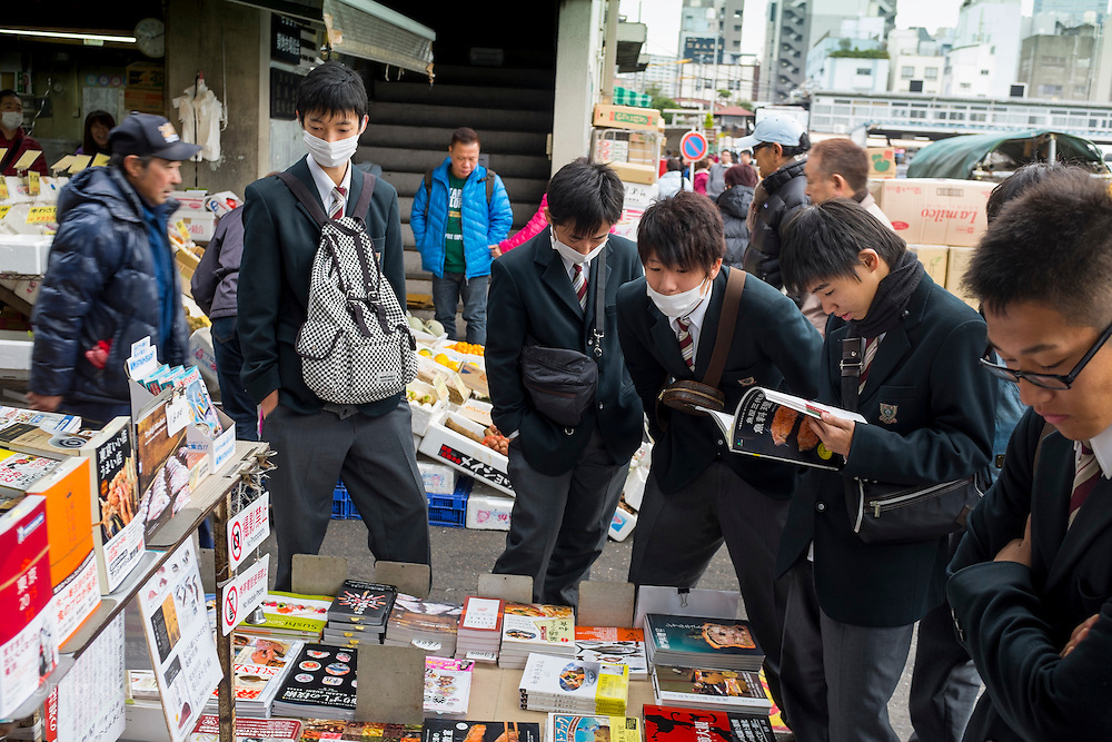Fish porn: Schoolboys are rapt at attention, looking at books on fish and sushi, at the world famous Tsukiji Fish Market. Many school groups come there from all over Japan.