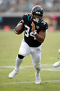 Jacksonville Jaguars running back Carlos Hyde (34) runs for a second quarter gain of 5 yards to the Indianapolis Colts 9 yard line that was negated by a penalty during the NFL week 13 regular season football game against the Indianapolis Colts on Sunday, Dec. 2, 2018 in Jacksonville, Fla. The Jaguars won the game in a 6-0 shutout. (©Paul Anthony Spinelli)