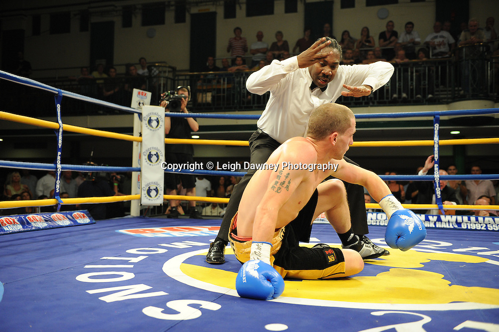 Referee counts Ryan Toms after Steve O'Meara knocked him down at The Southern Area Light-Middleweight Championship at York Hall, Bethnal Green, London on Friday 30th September 2011. Box Nation.tv's debut live TV Channel 456 on Sky. Photo credit: © Leigh Dawney. Queensberry Promotions.