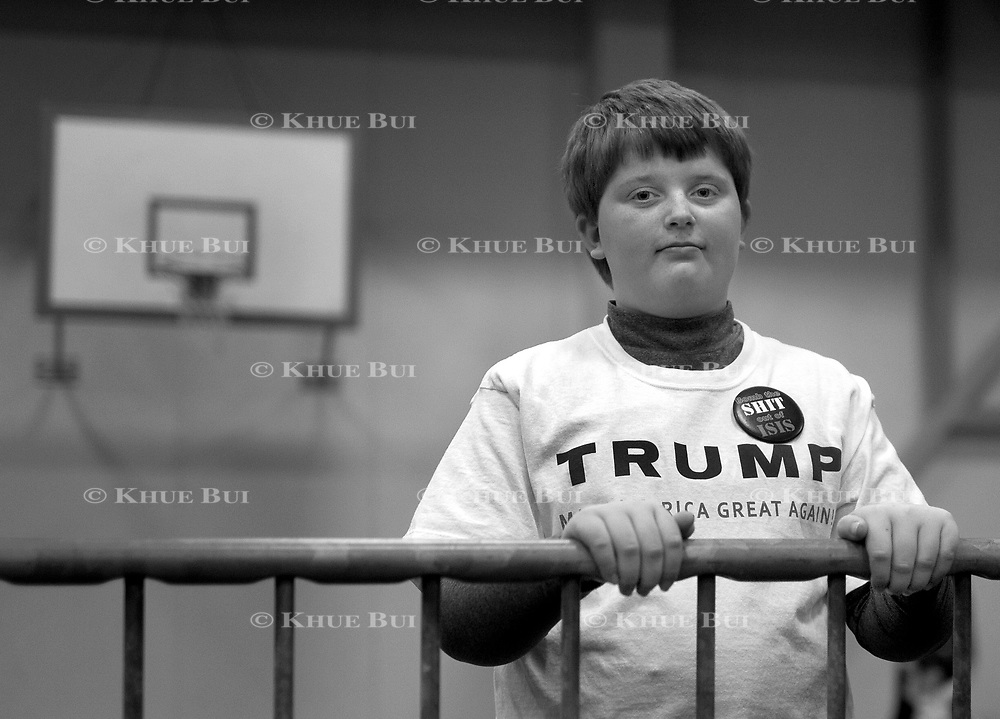 Dillon Schmidt, 11, of Tiffin,IA, attends the rally of Republican presidential candidate Donald Trump Tuesday, January 26, 2015, in Iowa City, IA.  Note the pin of his shirt which says &quot;Bomb the SHIT out of ISIS&quot;.<br /> <br /> Photo by Khue Bui