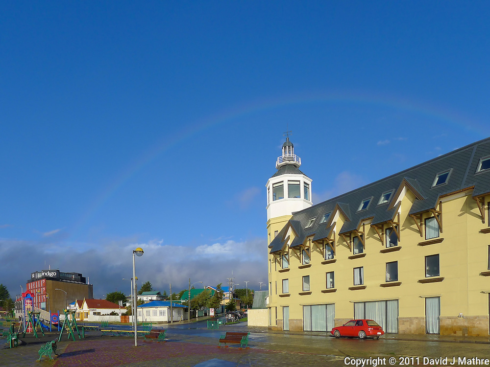 Hotel and Rainbow. Snapshot taken with a Leica V-Lux 20 camera (ISO 80, 5.1 mm, f/5.4, 1/1000 sec).