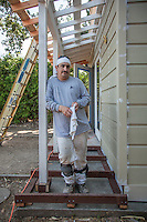 House painter and Calistoga resident, Abel Tovar, preps a building on School Street in Calistoga.