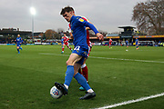 AFC Wimbledon defender Ryan Delaney (21) battles for possession in the corner during the EFL Sky Bet League 1 match between AFC Wimbledon and Gillingham at the Cherry Red Records Stadium, Kingston, England on 23 November 2019.