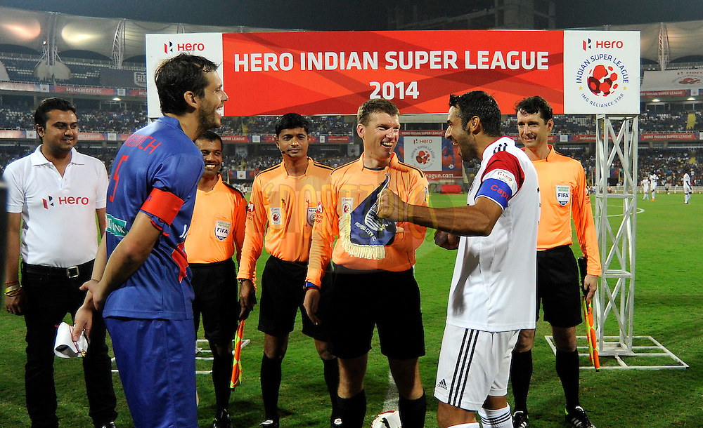 Manuel Friedrich of Mumbai City FC and NorthEast United FC captain Miguel Garcia during the toss before the start of match 11 of the Hero Indian Super League between Mumbai City FC and North East United FC City held at the D.Y. Patil Stadium, Navi Mumbai, India on the 24th October 2014.<br /> <br /> Photo by:  Pal Pillai/ ISL/ SPORTZPICS