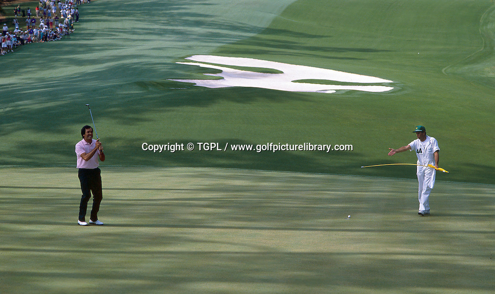 Seve BALLESTEROS (SPN) misses putt at 10th par 4 as his caddie,brother Vincente,looks on during US Masters 1988,Augusta National,AugustaGA ,USA.