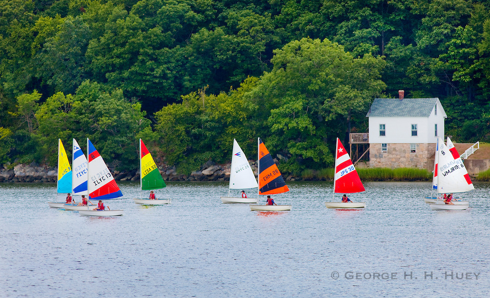 351021-1005G.Huey ~ Copyright: George H.H. Huey ~ Children in fleet of racing sailboats in the Mystic River.  Mystic, Conecticut.