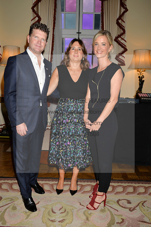 Left to right, US Ambasador MATTHEW BARZUN, ALEXANDRA SHULMAN and MRS BROOKE BARZUN at a party to kick off London Fashion Week hosted by US Ambassador Matthew Barzun and Mrs Brooke Brown Barzun with Alexandra Shulman in association with J.Crew hrld at Winfield House, Regent's Park, London on 18th September 2015.