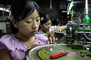 Burmese workers in a textil factory in mae Sot...Near the border with Burma grow up tens of factories that use manpower from Burma : legal migrant or illegal ones that cross the border daily in order to find a job.