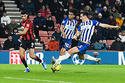Dominic Solanke (9) of AFC Bournemouth crosses the ball to Diego Rico (21) of AFC Bournemouth for his shot at goal during the Premier League match between Bournemouth and Brighton and Hove Albion at the Vitality Stadium, Bournemouth, England on 21 January 2020.