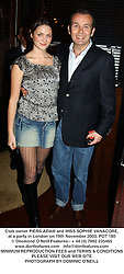 Club owner PIERS ADAM and MISS SOPHIE VANACORE, at a party in London on 19th November 2003.POT 180