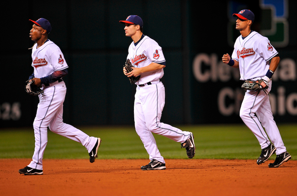 CLEVELAND - OCTOBER 15: Kenny Lofton, Grady Sizemore and Franklin Gutierrez of the Cleveland Indians run off the field after defeating the Boston Red Sox in Game Three of the American League Championship Series at Jacob's Field on October 15, 2007 in Cleveland, Ohio. The Indians defeated the Red Sox 4 to 2.