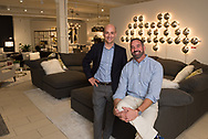 Photo of principals of Mitchell Gold furniture store in Boston.