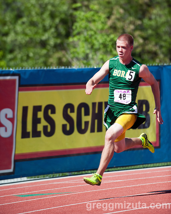 Borah senior Karsten Niederer on the turn in the Idaho 5A State Track & Field Championships 200 meter final at Dona Larsen Park, Boise, Idaho on May 17, 2014. Niederer finished second in 21.83.