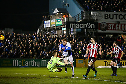 Rory Gaffney of Bristol Rovers collides with Simon Moore of Sheffield United as he scores aheaed goal but is ruled offside - Rogan Thomson/JMP - 14/02/2017 - FOOTBALL - Memorial Stadium - Bristol, England - Bristol Rovers v Sheffield United - Sky Bet League One.