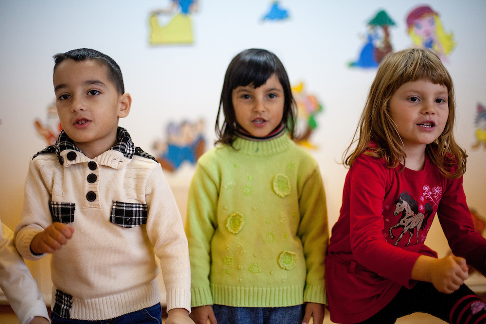 A group of children - Roma and Non Roma - performing at the new reconstructed local kindergarten in Marginenii de Jos.