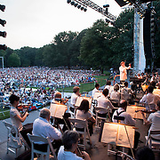 July 17, 2012 - New York, NY : Conductor Andrey Boreyko, standing, leads the New York Philharmonic in Richard Wagner's 'Prelude to Act I of Die Meistersinger (1862-67)' in Central Park on Monday evening. CREDIT: Karsten Moran for The New York Times