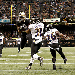 Nov 24, 2014; New Orleans, LA, USA; New Orleans Saints wide receiver Marques Colston (12) catches a 26 yard touchdown past Baltimore Ravens free safety Terrence Brooks (31) and strong safety Matt Elam (26) during the second quarter of a game at the Mercedes-Benz Superdome. Mandatory Credit: Derick E. Hingle-USA TODAY Sports