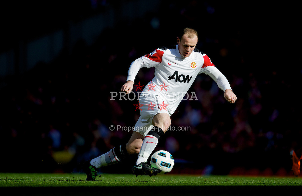 LIVERPOOL, ENGLAND - Sunday, March 6, 2011: Manchester United's Wayne Rooney in action against Liverpool during the Premiership match at Anfield. (Photo by David Rawcliffe/Propaganda)