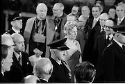 Inaugeration of Cearbhall O'Dalaigh as President  (H77).1974..19.12.1974..12.19.1974..19th December 1974..Following the sudden death of President Erskine Childers, Mr Cearbhall O'Dalaigh was nominated by The Fianna Fail party as its candidate to replace him. The Fine Gael /Labour coalition government did not oppose the nomination and Mr O'Dalaigh was elected un-opposed on a joint party agreement...Image of President Cearbhall O'Dalaigh and his wife Mairin being escorted from the hall after his inaugeration. President O'Dalaigh would later host a State Reception to celebrate his inaugeration.